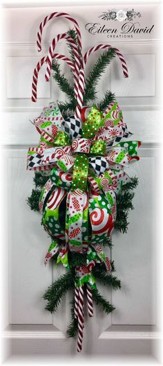 Whimsical Candy Cane Swag by Christmas Front Doors, Christmas Mesh Wreaths, Christmas Swags, Christmas Lanterns, Christmas Decorations, Christmas Ornaments, Winter Wreaths, Burlap Christmas, Christmas Christmas