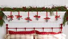 Create an above-the-bed shelf that looks like a festively adorned mantel during the holidays. -- Lowe's Creative Ideas