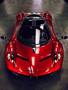 Red Candy Apple Pagani Huayra | More here: http://mylusciouslife.com/stylish-home-luxury-garage-design/