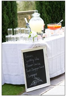 drink bar with the various large glass pitchers and a chalkboard menu in a refurbished frame!