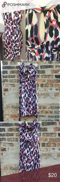 Guess Abstract Keyhole Tie-Waist Halter Dress Beautiful & flattering dress with purple, blue, pink, and white colors. Features a halter top style with cute button details. A key hole opening and a tie waist. Size large. Some very small staining in inside of collar. Guess Dresses