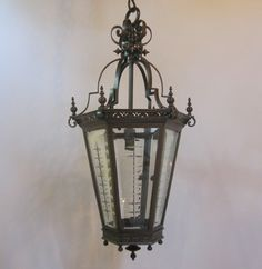 Good size six sided lantern by Faraday & Son of London. The patinated brass metal work is very much in the style of the Aesthetic movement. www.antiquelightingcompany.com