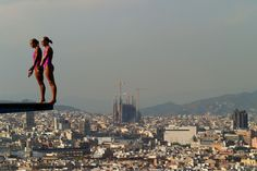 Zsofia Reisinger and Gyongyver Villo Kormos of Hungary compete in the Women's 10m Platform Synchronised Diving final on day three of the 15th FINA World Championships at Piscina Municipal de Montjuic on July 22, 2013 in Barcelona, Spain.