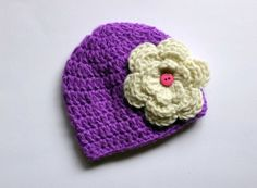 Hey, I found this really awesome Etsy listing at https://www.etsy.com/listing/181124561/purple-flower-baby-crochet-hat
