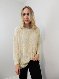 Open knit cream sweater with back cross stitching