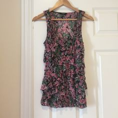 FIRM PRICE Dressy Tank Top New without tags. Size Medium. Ruffles on front. 100% Nylon. Cute floral pattern. Black, pink, green, white. Have questions let me know. Make me an offer! Express Tops Tank Tops