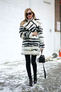 See how all of the New York Fashion Week attendees are keeping warm AND chic outside the shows: