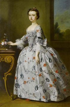 'Bartholomew Dandridge (British, 1691-1755), Portrait of a girl with a basket of flowers.' This grandly-dressed girl is still dressed as a child,the hanging strip to be seen at the back of her dress being one of a pair of leading strings. Such strings symbolized her dependance on her parents. Her gown - as most children's gowns did - would have laced up the back.