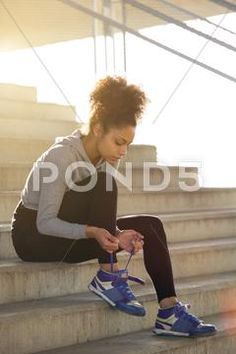 Young exercise woman tying her shoelaces Stock Photos