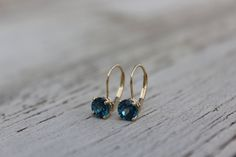 14k Yellow Gold 6mm London Blue Topaz by RavenFineJewelers on Etsy