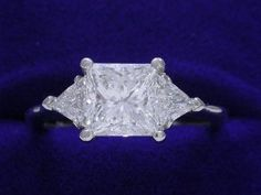Princess Cut Diamond Ring: 1.52 carat with 0.39 tcw Trillion Cut Diamonds