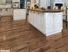 Wood tile- Floor features the American Heritage series in color Saddle.