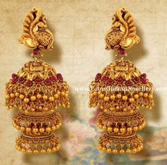 3 step long antique gold jhumkas in peacock design embellished with pota rubies and gold muvvalu. These long heavy earrings are all you need for the next party. Gold Jhumka Earrings, Indian Jewelry Earrings, Jewelry Design Earrings, Gold Earrings Designs, Indian Wedding Jewelry, Ear Jewelry, Designer Earrings, Beaded Jewelry, Gold Designs