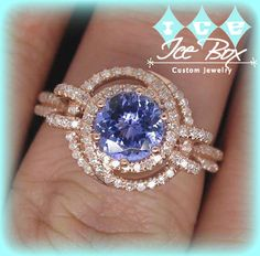 Tanzanite Engagement Ring 1.45ct 6.5mm Round Cut Tanzanite in a Diamond Knot Halo Double Shank setting  $1,180.00