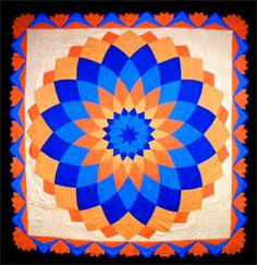 This Giant Dahlia quilt, was made by Ella Strahm in 1887,