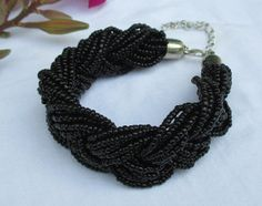 Black braided bead bracelet beaded bracelet by newjewelryarts, $9.00-- would also look good as a matching necklace****
