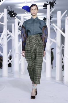 """""""You can't rush couture, darling."""" It was a refrain one could mentally hear a model coach instructing her charges in a run-through of the Delpozo Fall 2015 runway show. The resulting pace was a slo..."""