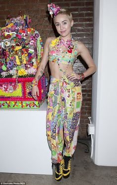 Wild look: Miley Cyrus debuted her first art installation entitled 'Dirty Hippie' as part of designer Jeremy Scott's New York Fashion Week show on Wednesday