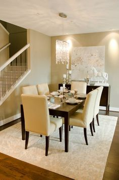 dining rooms - crystal chandelier gray rug espresso modern buffet (minus the white horse statue) glossy espresso lacquer sleek dining table camel Parsons dining chairs gray rug