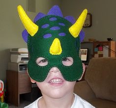 kylan wearing his dinosaur mask DIY