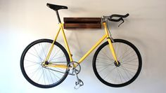 Interior, Wonderful Bike Storage Ideas Wall Hanging Wooden Design Modern Minimalist Interior With Smart Saving Space Yellow Bike ~ Brilliant Bike Storage Ideas in Maximizing the Space Available