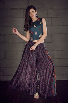 Chanderi-satin crop top and flare pants embellished with resham embroidery by #Benzer #Benzerworld #PalazzoPants #IndoWestern