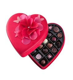 Romantic Heart, an alluring gift box dressed in cherry red fabric and beautifully presented with a ruched rose.Its offers your loved one a luxurious selection of Godiva's finest ganaches, pralines, truffles and caramels. #chocolates for you Godiva Medium Fabric Heart 23 chocolates