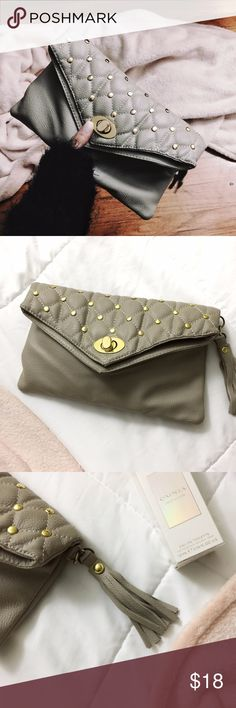 """Taupe+Gold Studded Quilted Tassel Envelope Clutch Taupe+Gold Studded Quilted Tassel Envelope Clutch Adorable Folded envelope style clutch--also can be a mini crossbody, has hooks for a strap. Still in good condition, just has some scraping on the front closure (pictured above) + Scraping on the inside zipper. Interior has 2 pockets + one zipper pouch. Exterior features a quilted style, with gold studded embellishments--all still intact.  With cute side Tassel.   Approximate Measurements:  6""""…"""