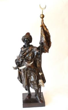 A large patinated bronze figure of an Orientalist Warrior by Henri Plé.