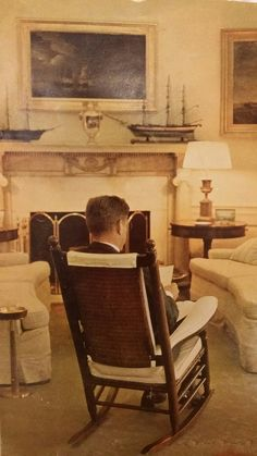 President John F. Kennedy sitting in his rocking chair. It helped to ease his…