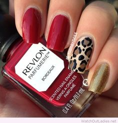 Red nails with gold accents