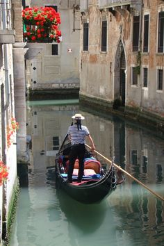 The gondola is a treasure of Venice, with the gondolier wearing his hat and…