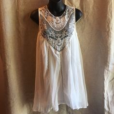 "Lace Flowy Cream Sundress Gorgeous dress! It is semi sheer so you will need to layer. You can wear as a dress or as a tunic. Please read the measurements before purchasing. The medium and small come in the all cream and the large is a separate listing with a white/cream combo. Medium: bust- 18"" length- 32""; Small: bust- 17"" length- 32"". Dresses"
