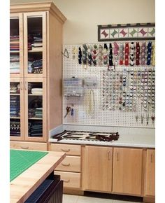 Flaunt it. Make no mistake, this sewing room is organized to a T using pegboard. Costing about $20 for 16 square feet, pegboard is an affordable organizing option that can't be overlooked.