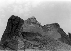 1933- the not-yet-completed Mount Rushmore Memorial