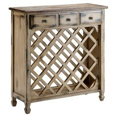 Perfect for stowing your favorite reds and whites, this rustic wine cabinet features 3 drawers and space for 21 bottles. Product:...
