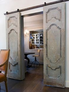 antique doors on a roller. Something like this instead of pocket doors if we close off sitting room