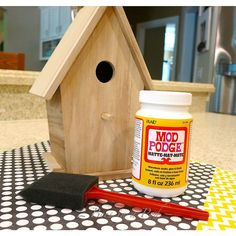 I'm a painter myself but this is pretty cute. DIY Decorative Birdhouse With Vintage Book Pages and Scrapbook Paper