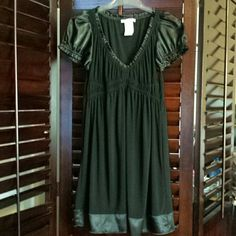 Pretty black dress with a satin trim This dress is adorable on. It's in good condition. The sleeves, the trim on the v neck and the bottom of the dress is a satin material. wishes Dresses Midi