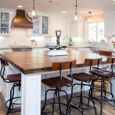 Kitchen:  Like the lighting, island with butcher block, cabinet hardware, and chairs