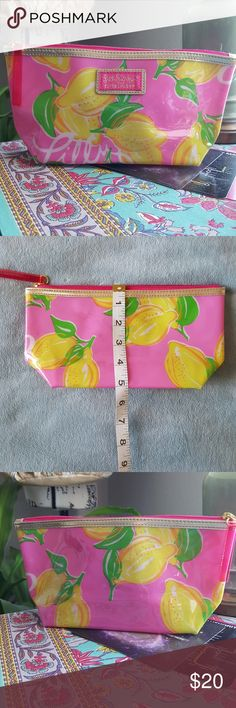 Lilly Pulitzer for Estee Lauder Lemons Make up Bag Cute and colorful! Bright pink wirh bright lemmons make this part of Lilly's iconic look. GUC with minor transfer discoloration on the back as shown in photos. Inside is perfect. Lilly Pulitzer Bags Cosmetic Bags & Cases