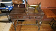 Domestic Sewing machine co, made by white sewing machine co. In a wonderful antique cabinet in the parlor or vanity style.