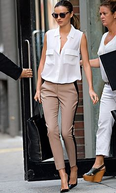 sleeveless equipment blouse, cropped a.l.c beige trousers with black vertical stripes, glossy tortoiseshell manolo blahnik pumps, and stella mccartney sunglasses.