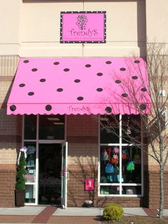 A perfect example of how an awning can make your storefront memorable.