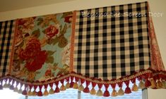Multi fabric board mounted valance with box pleated ends.
