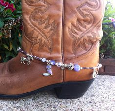 Boot Bling / Boot Candy - This boot bling is perfect for your purple loving cowgirl. Dress up your cowboy boots or any pair of boots for that matter with this boot jewelry. Its adjustable and should fit about any type of boot. In addition to czech glass and amethyst stone beading, the strand has swavorski crystal beads and silver plated spacers. There is just the right amount of bling. $22.00