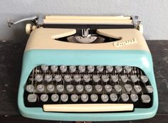 Vintage Antique Rare Robin Eggs Blue and Yellow Consul Portable Travel Typewriter with Carrying Case.   Model 1531.  Czechoslovakia.