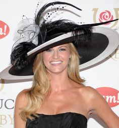 Kentucky Derby Hats - HIT: Erin Andrews    And they're off! Here's a look at the hits and misses of this year's Kentucky Derby hats. —Alexis Jonnson    It's best to stick with neutral colors when going for such an elaborate headpiece, but Erin has the personality to pull off such an over-the-top hat. (I love this!!)