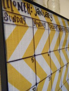 DIY: Dry erase Calendar  A perfect way to make it your own.  12x16 frame, fabric, command strips, permanent marker,and a ruler! I love mine!