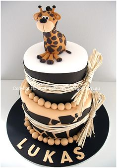 Our original and very popular Jungle Theme Christening cake featuring a hand sugarcrafted baby giraffe figurine.    This design will perfectly suit a combined Christening and Birthday celebration.